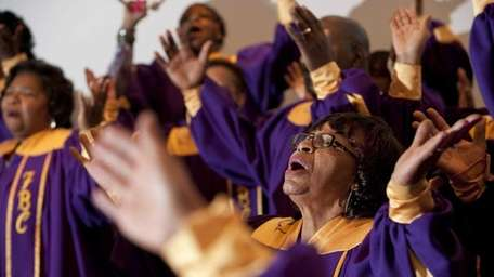 The gospel choir practices Sunday afternoon at the