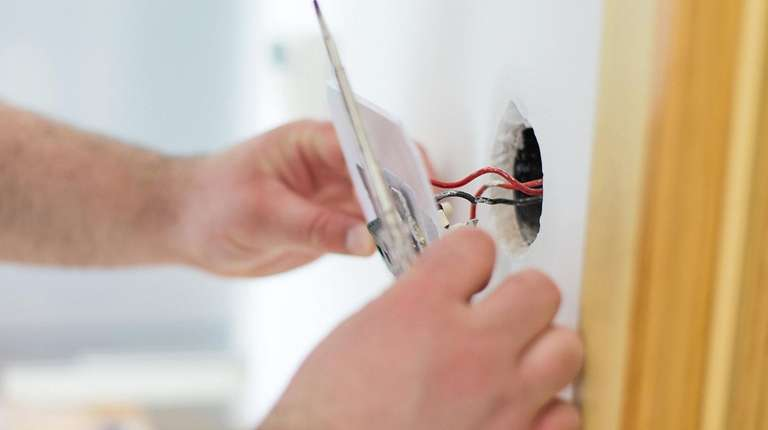 Have an electrician move light switches where they