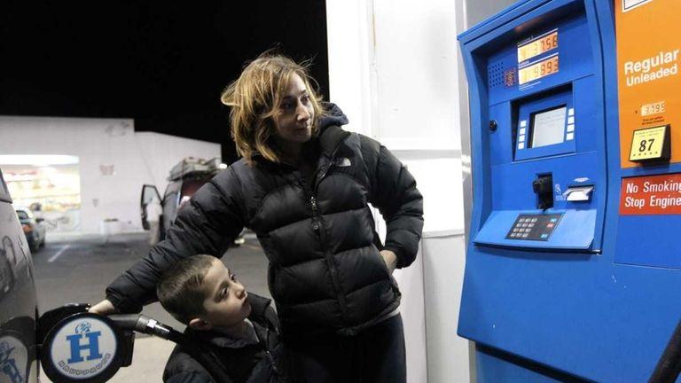 Laura Mansi of Hauppauge pumps 16 gallons of