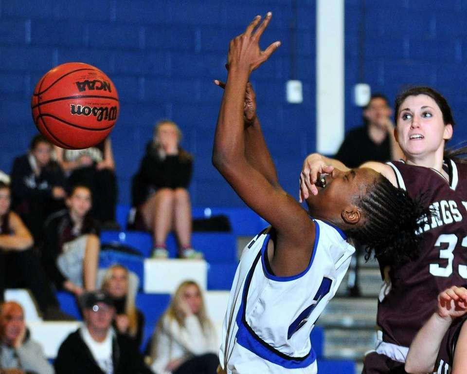 Tamara Simpson, left, draws a foul on Taylor