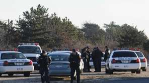 Police gather at a staging area at Oak