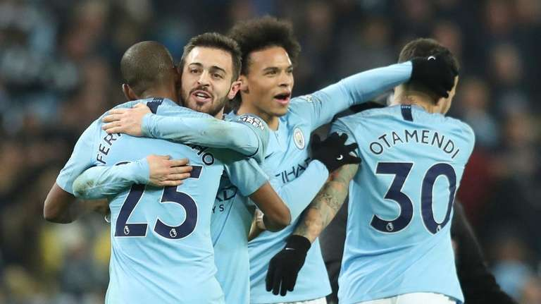Manchester City's Leroy Sane, second right, celebrates with