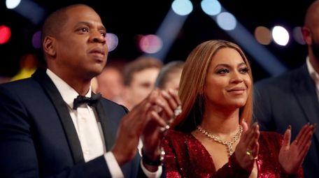 Jay-Z and Beyoncé attend the 59th Grammy Awards