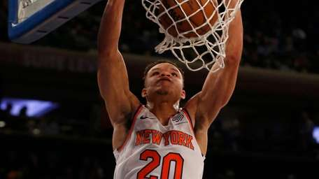 The Knicks' Kevin Knox dunks the ball during