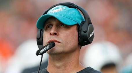 Then-Dolphins head coach Adam Gase stands on the