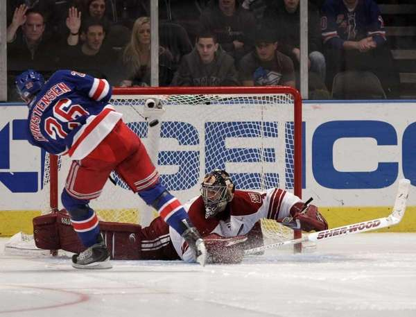 New York Rangers' Erik Christensen (26) scores on