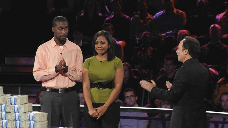 Contestants Brittany, center, and Gabe, left, participate for