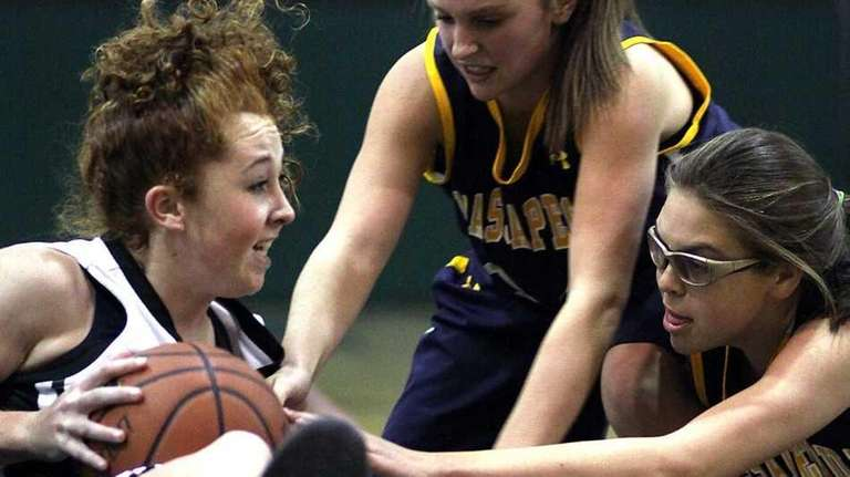 Farmingdale's Colleen Reynolds is surrounded by Massapequa defenders