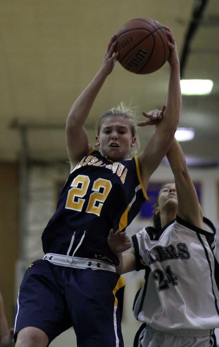 Massapequa's Lauren Van Buren rebounds against Farmingdale, as