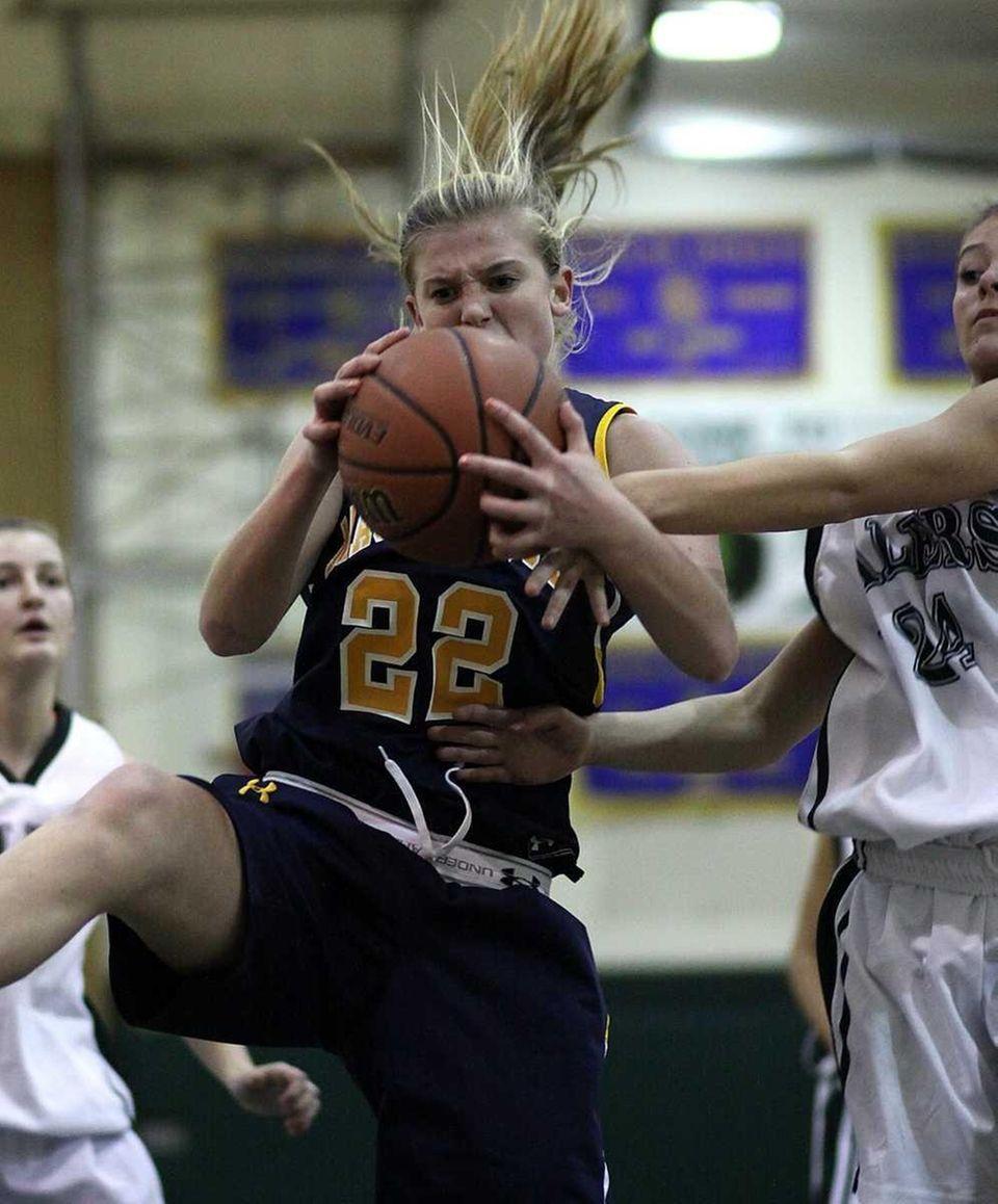 Massapequa's Lauren VanBuren pulls down a rebound as