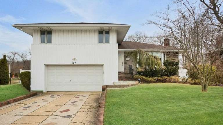 This split-level is listed for $697,500.