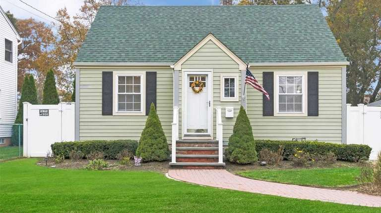 This Islip Terrace Cape is listed for $339,999.