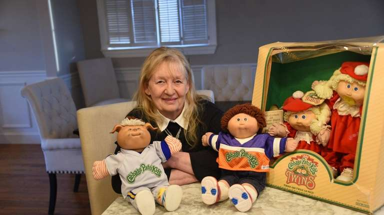 Linda Hoffman, 72, poses with her collection of