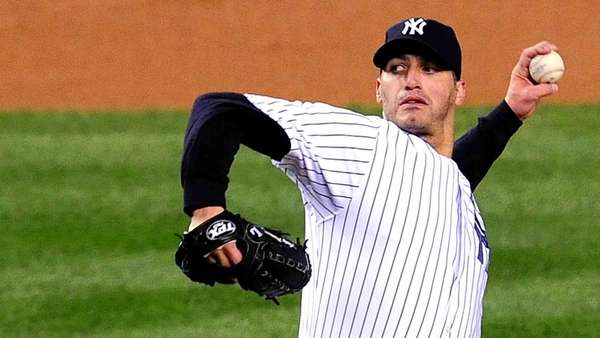 Andy Pettitte delivers a pitch during an ALCS