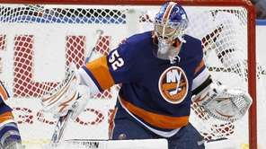 Islanders goalie Nathan Lawson stops a shot by