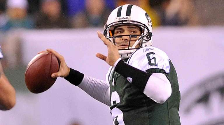 Mark Sanchez looks for a receiver in the