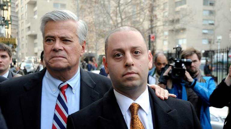 Dean Skelos and his son Adam leaving federal