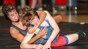 Julien Vivas of Newfield wrestled Calvin Pedatella of