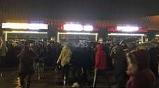 Billy Joel fans stand in the pouring rain
