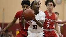 Malachi Coleman (10) of Bay Shore shoots against