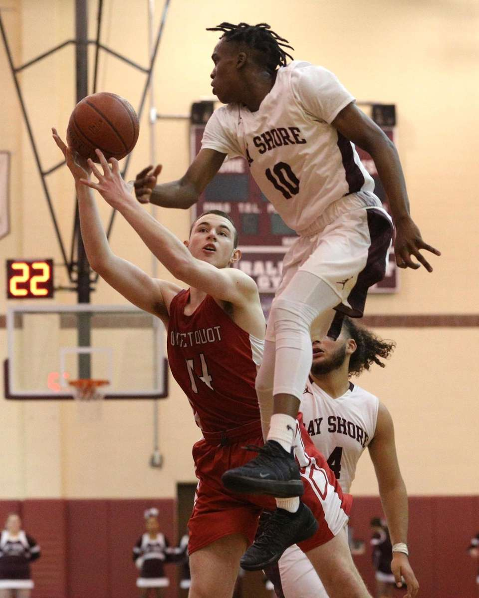 Malachi Coleman (10) of Bay Shore knocks the