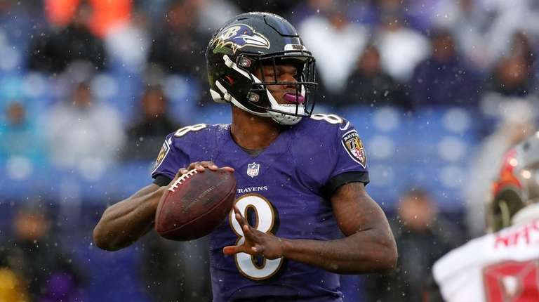 BALTIMORE, MARYLAND - DECEMBER 16: Quarterback Lamar Jackson