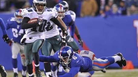 New York Giants punter Matt Dodge leaps for