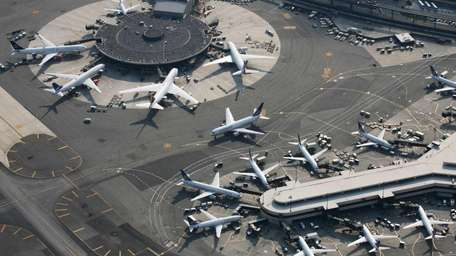 Passenger planes are parked at Newark Liberty International