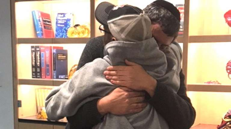 Simon and Levitz embrace after meeting in person
