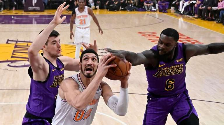 New York Knicks center Enes Kanter tries to