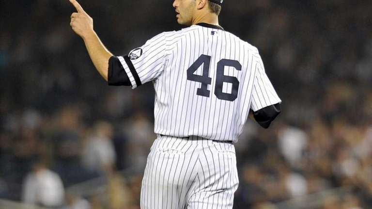 Andy Pettitte stands on the mound during a