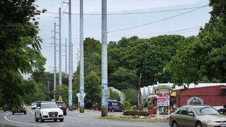 The steel poles on Eastport Manor Road in