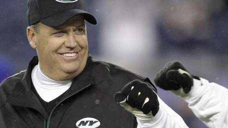 Jets head coach Rex Ryan fists bumps one