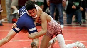 Bay Shore's Elijah Rivera wrestles Bayport Blue Point's