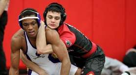 Mt. Sinai's Joe O'Brien wrestles Central Islip's Tyshawn