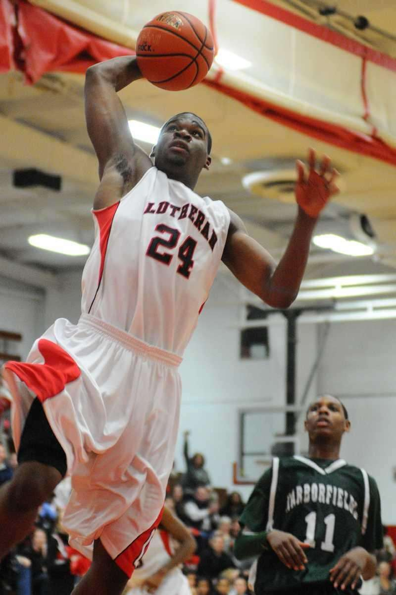 Long Island Lutheran's Achraf Yacoubou drives to the