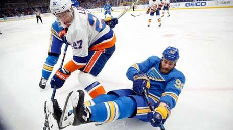 St. Louis Blues' Ryan O'Reilly (90) falls alongside