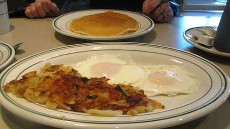 Eggs over easy, home fries, at Great Neck