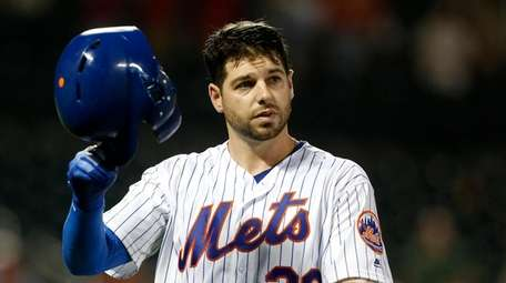 Kevin Plawecki #26 of the Mets reacts after