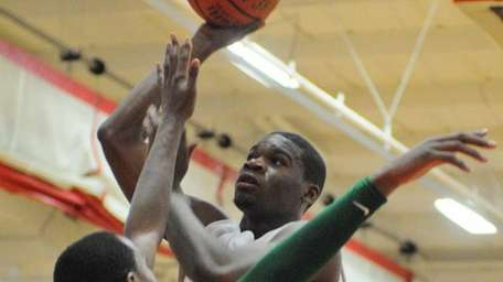 Long Island Lutheran's Achraf Yacoubou, right, shoots a