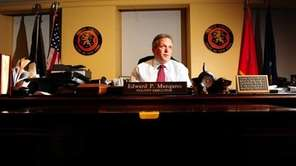 Nassau County Executive Edward Mangano works in his