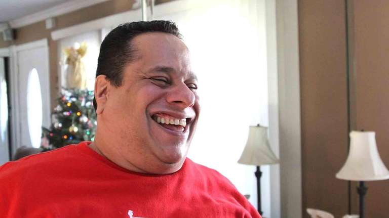 Ken George, a 9/11 first responder, reacts after