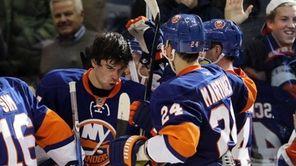 The Islanders' John Tavares celebrates his overtime goal