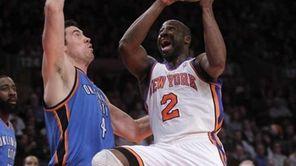 Knicks guard Raymond Felton goes for a layup