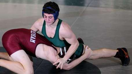 Bellmore JFK's Mike Pizzarusso, right, gets an advantage