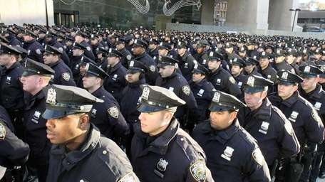 Police line up outside the Adam Clayton Powell