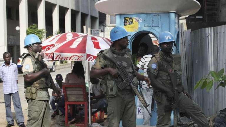 UN forces stand guard on a street in