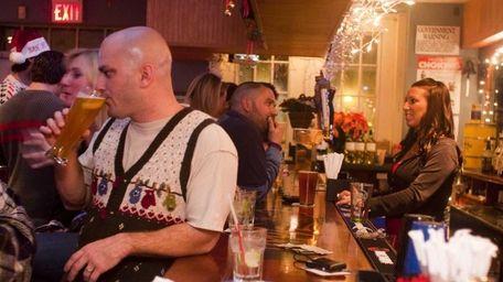 Patrons at the bar at Portside Bar and