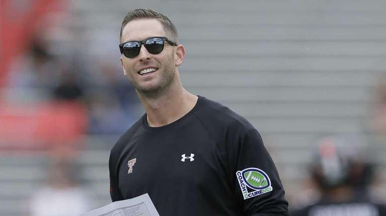 Texas Tech head coach Kliff Kingsbury walks the