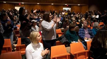 The local community gives a standing ovation Monday